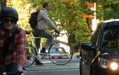 Cyclist in bike box on cycle track in Southwest Portland