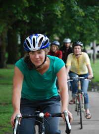 cyclists riding on a park trail