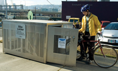 Cyclist using a bike locker