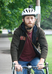 Bicyclist with helmet and light