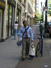 man walking with groceries