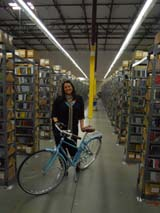 Portland's Yvonne Garcia with the new bike in CD Baby's warehouse
