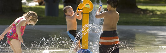 children playing in fountain